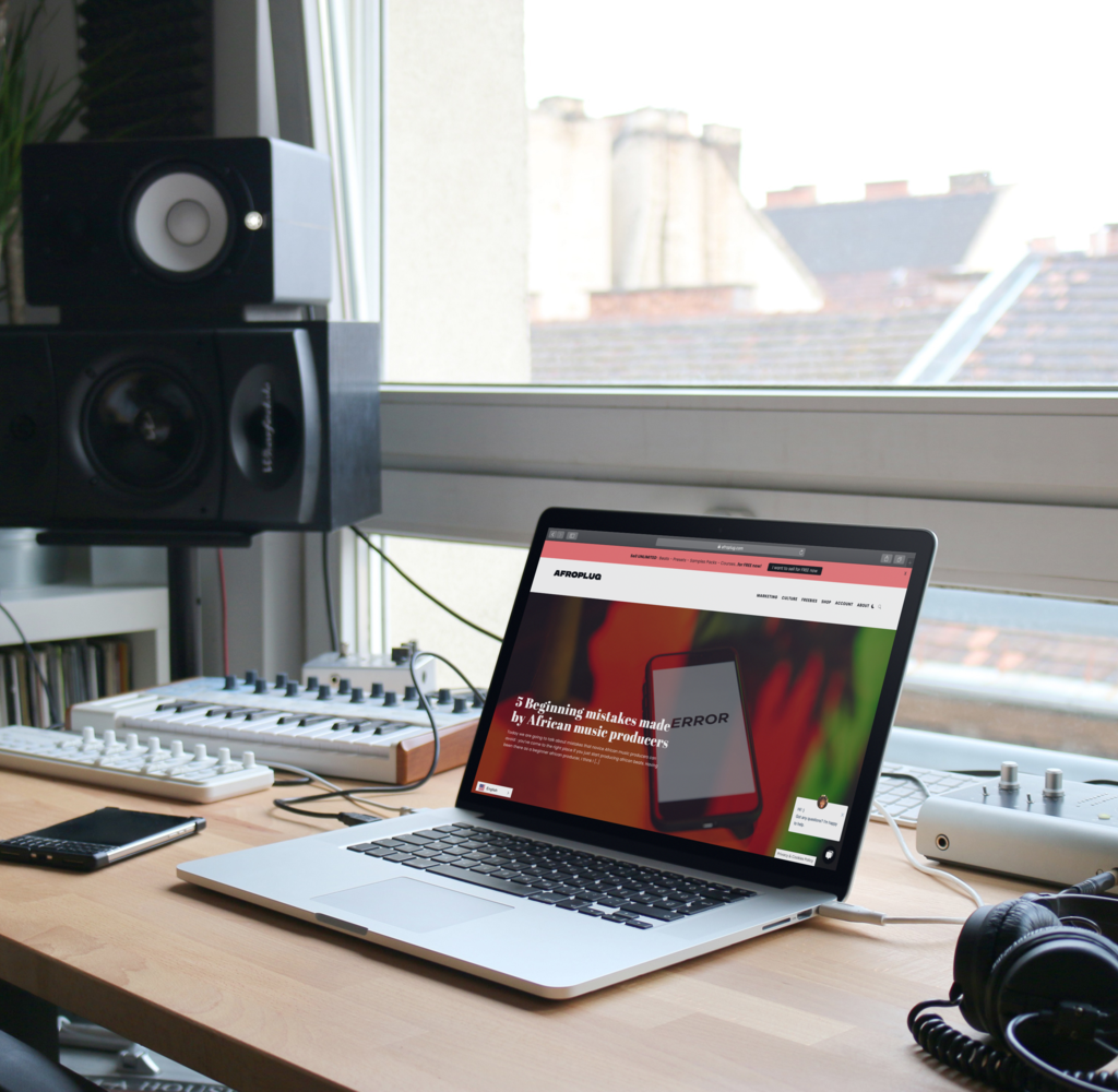 Home studio with a mackbook pro watching Aforplug's website